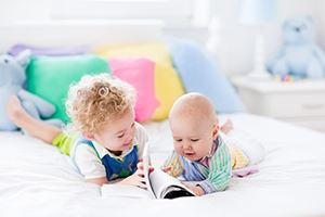 Little-Brothers-Reading-A-Book
