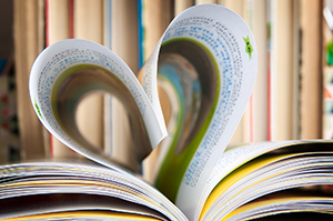 book with pages folded into a heart